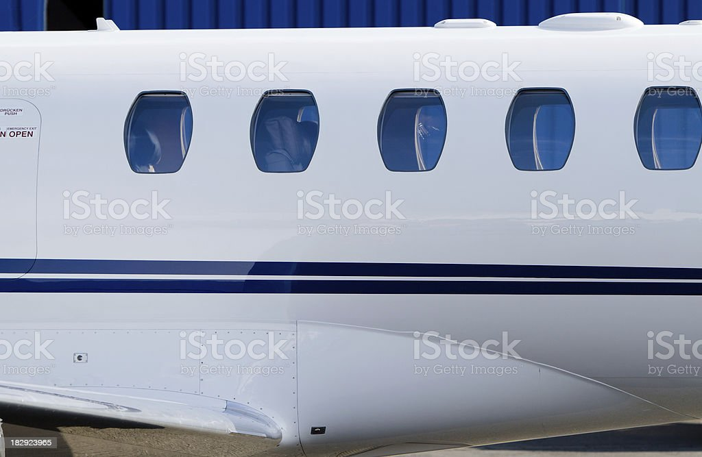 Passenger Windows of Corporate Jet royalty-free stock photo