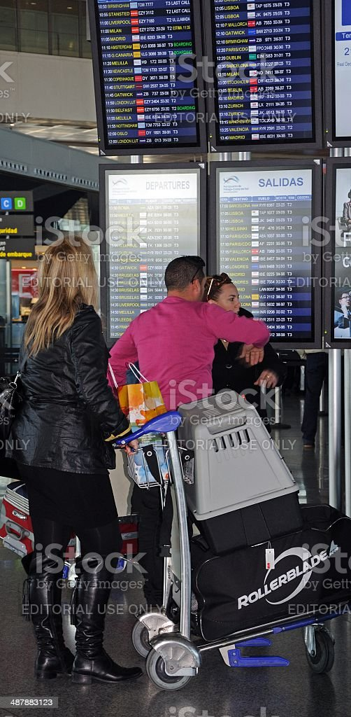 Passenger with pet carrier, Malaga airport. stock photo