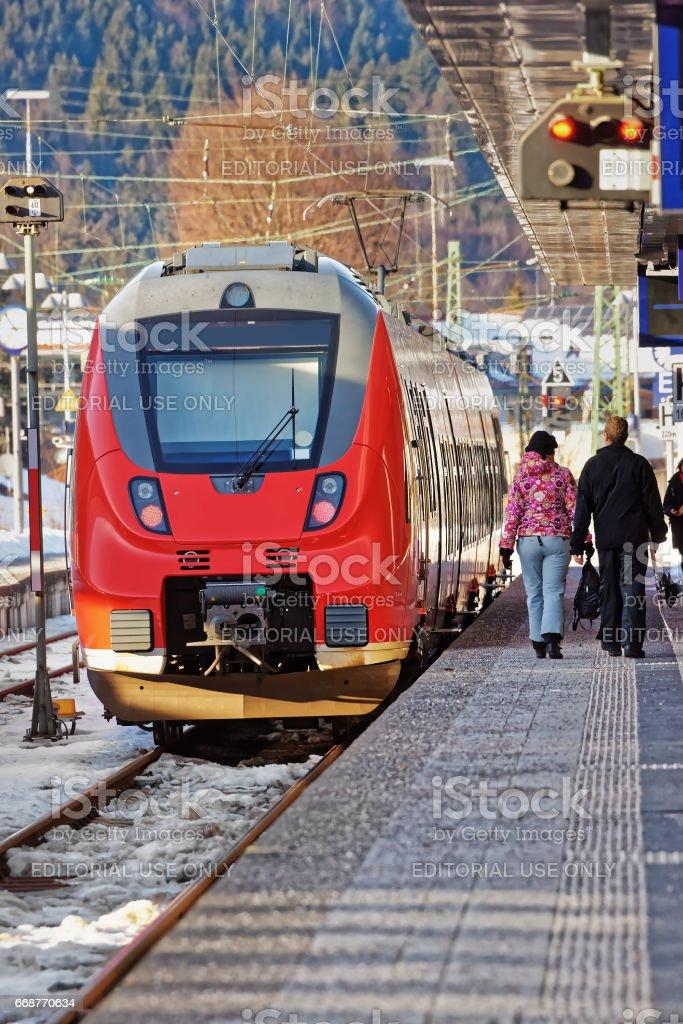 Passengers and high speed train at Garmisch Partenkirchen Germany stock photo