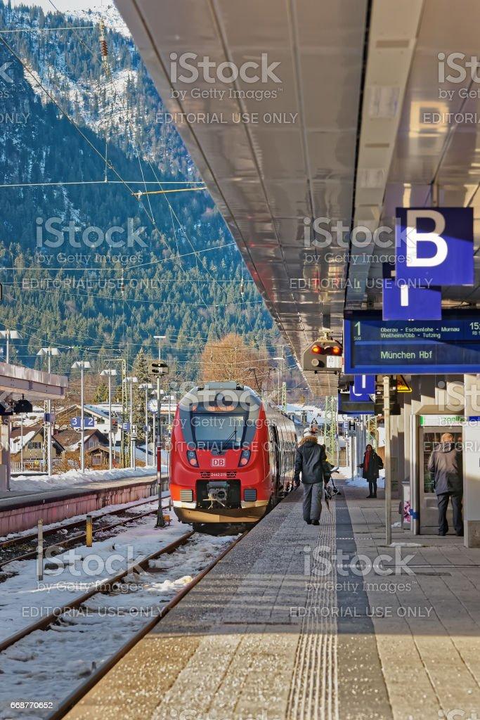 Passengers and high speed train Garmisch Partenkirchen Germany stock photo