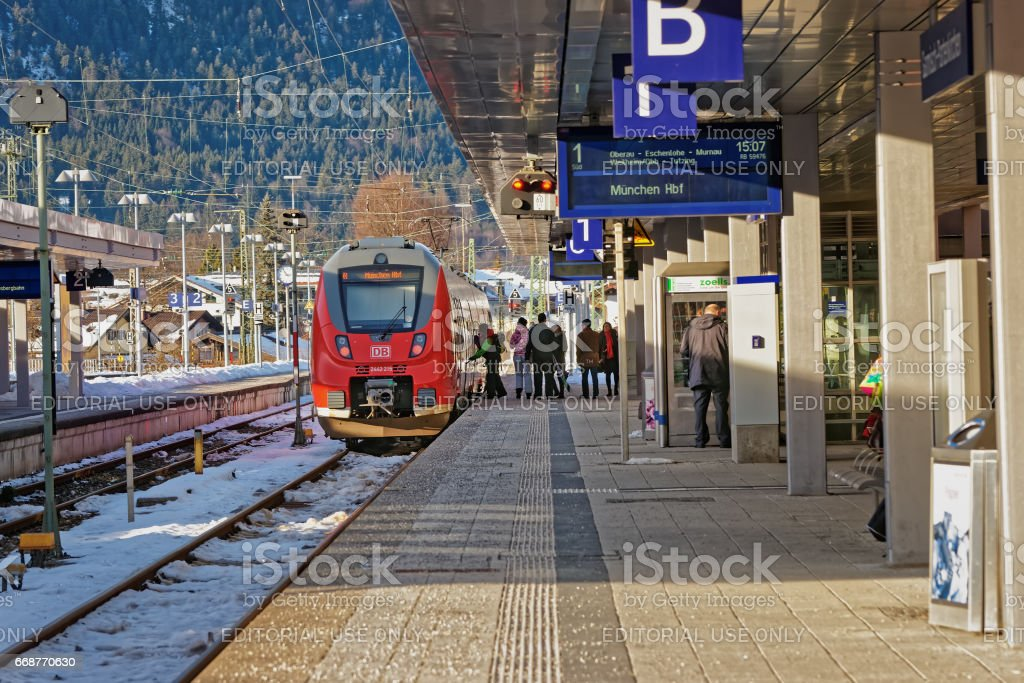 Passengers and high speed train Garmisch Partenkirchen in Germany stock photo