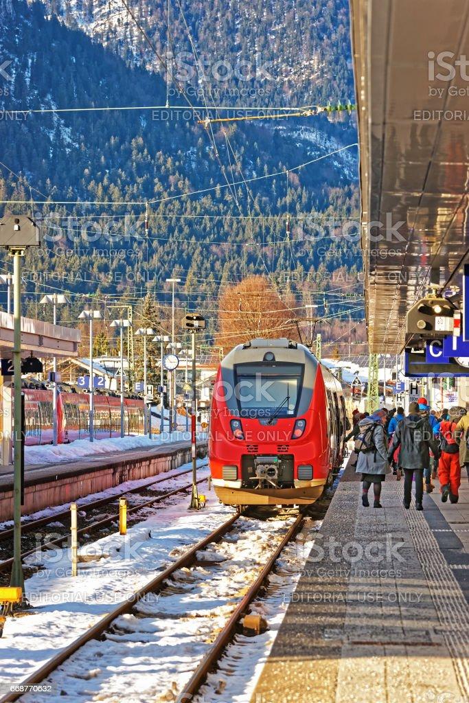 Passengers and high speed train in Garmisch Partenkirchen stock photo