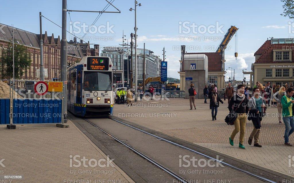 Passengers and Tram Platform near Amsterdam Centraal Railway Station stock photo