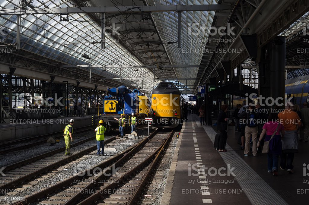 Passengers and Workers at Amsterdam Railway Station stock photo