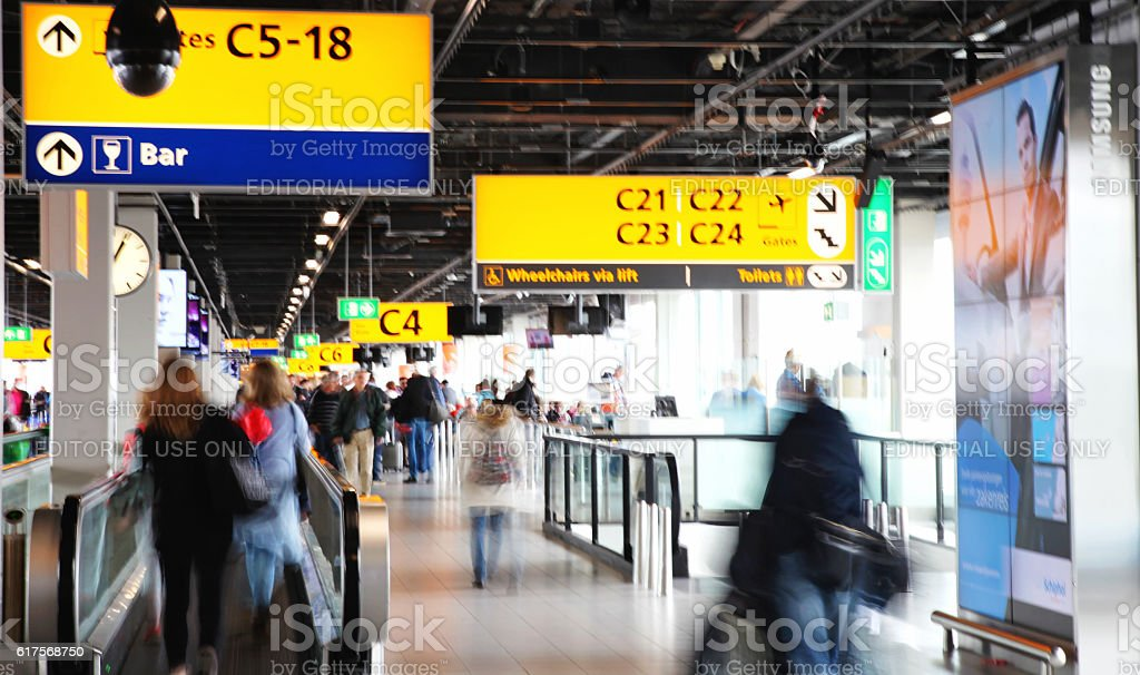 Passengers are walking in Amsterdam Airport Schiphol, Netherland stock photo