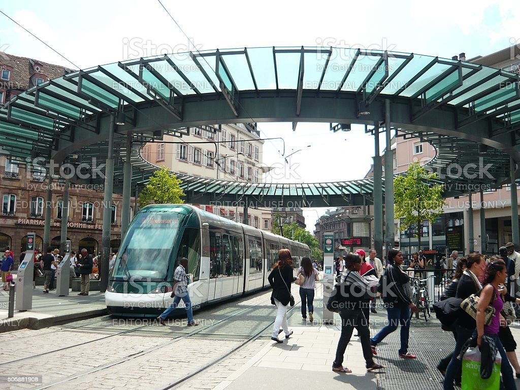 Passengers at a tram stop in Strasbourg, France stock photo