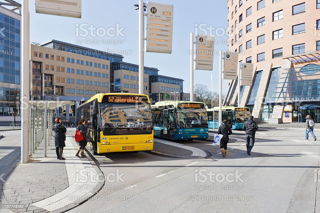 Passengers at bus station downtown Amersfoort, the Netherlands stock photo