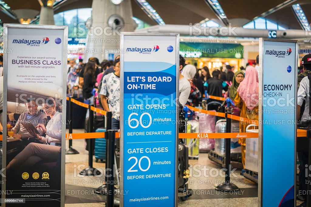 Passengers at Malaysian Airlines check-in counter, Kuala Lumpur international airport stock photo
