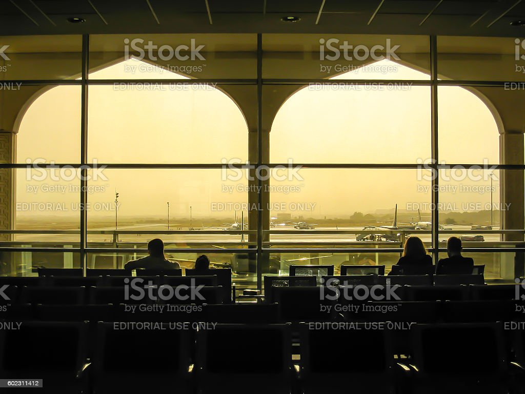 Passengers at Muscat airport in silhouette, Oman stock photo