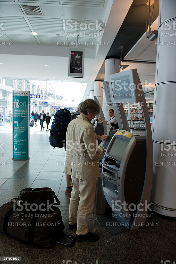 Passengers at the self-service check-in machine stock photo