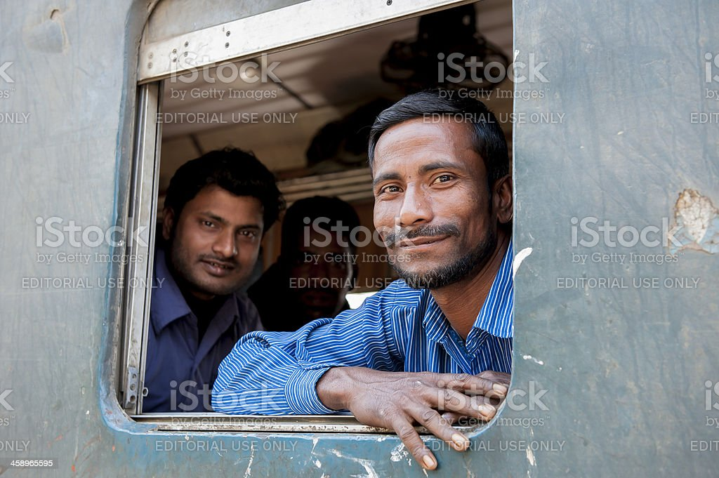 Passengers at the window of coach, Bangladesh royalty-free stock photo