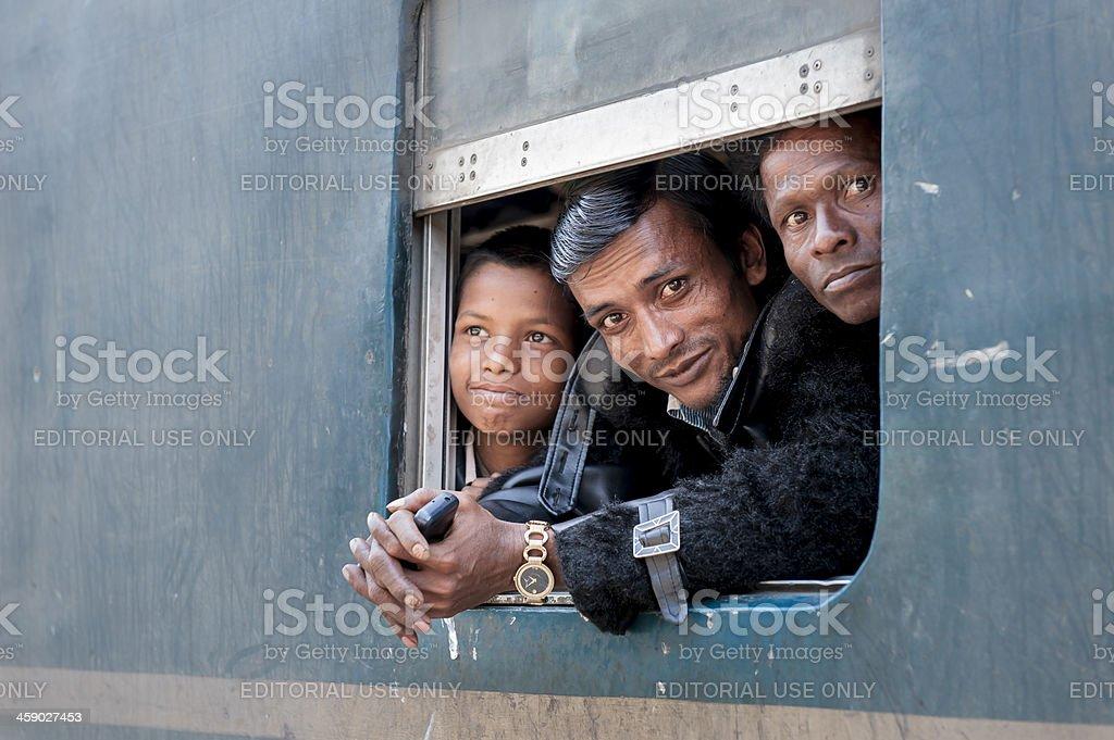 Passengers at the window of coach, Bangladesh royalty-free stock photo