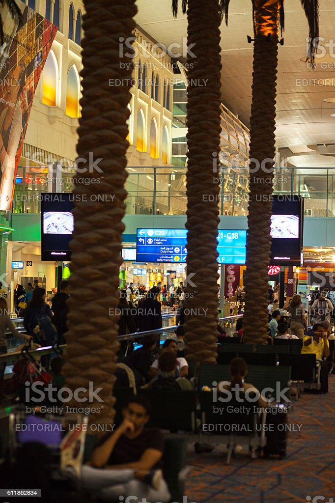 Passengers between palms in transit area stock photo