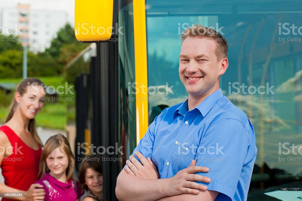 Passengers boarding a bus stock photo