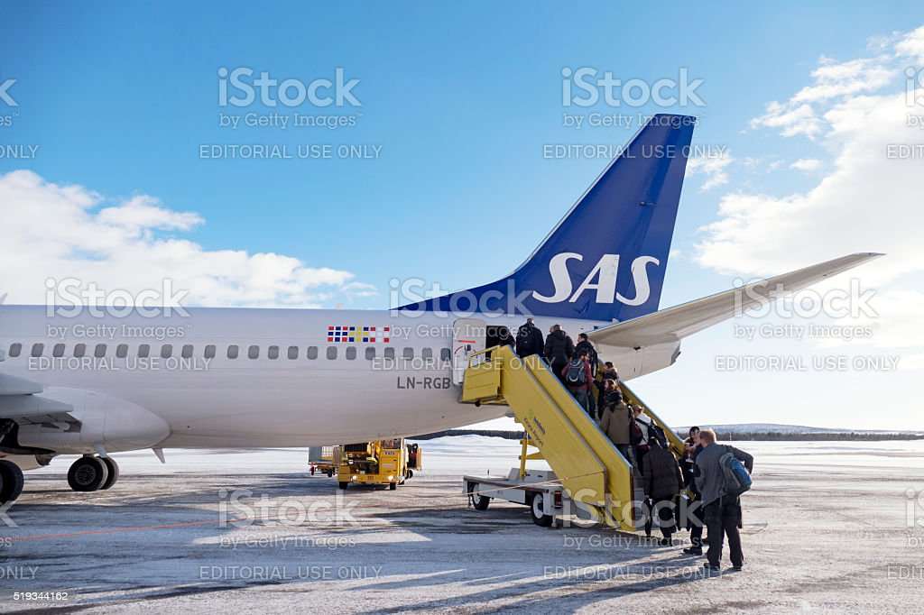 Passengers boarding aircraft from Scandinavian Airlines at Kiruna Airport, Sweden stock photo