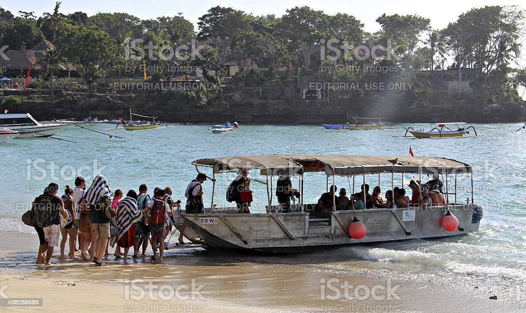 Passengers boarding boat to Bali royalty-free stock photo