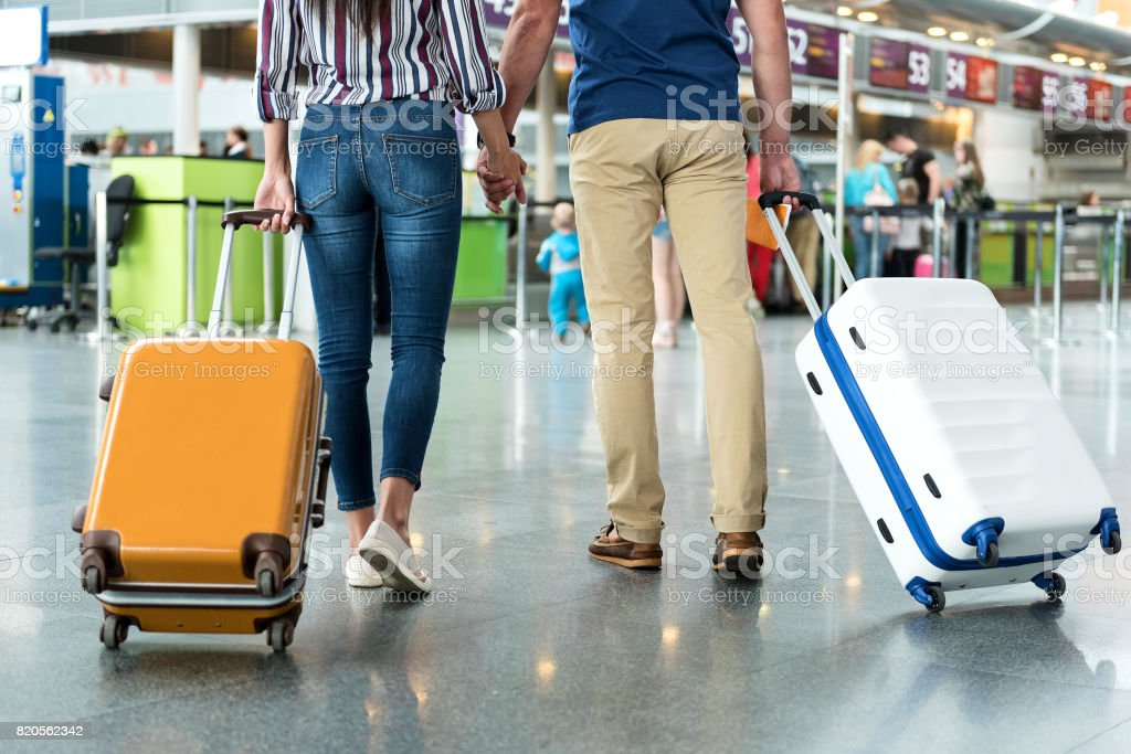 Passengers carrying their suitcase on wheels stock photo