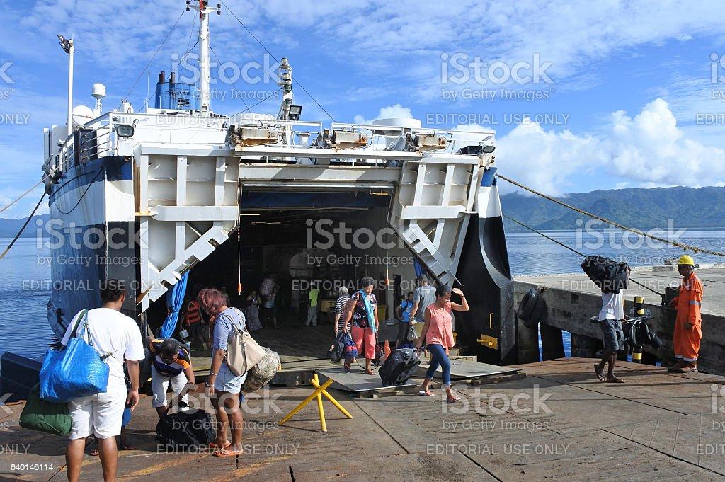 Passengers departing of inter island ferry in Fiji stock photo