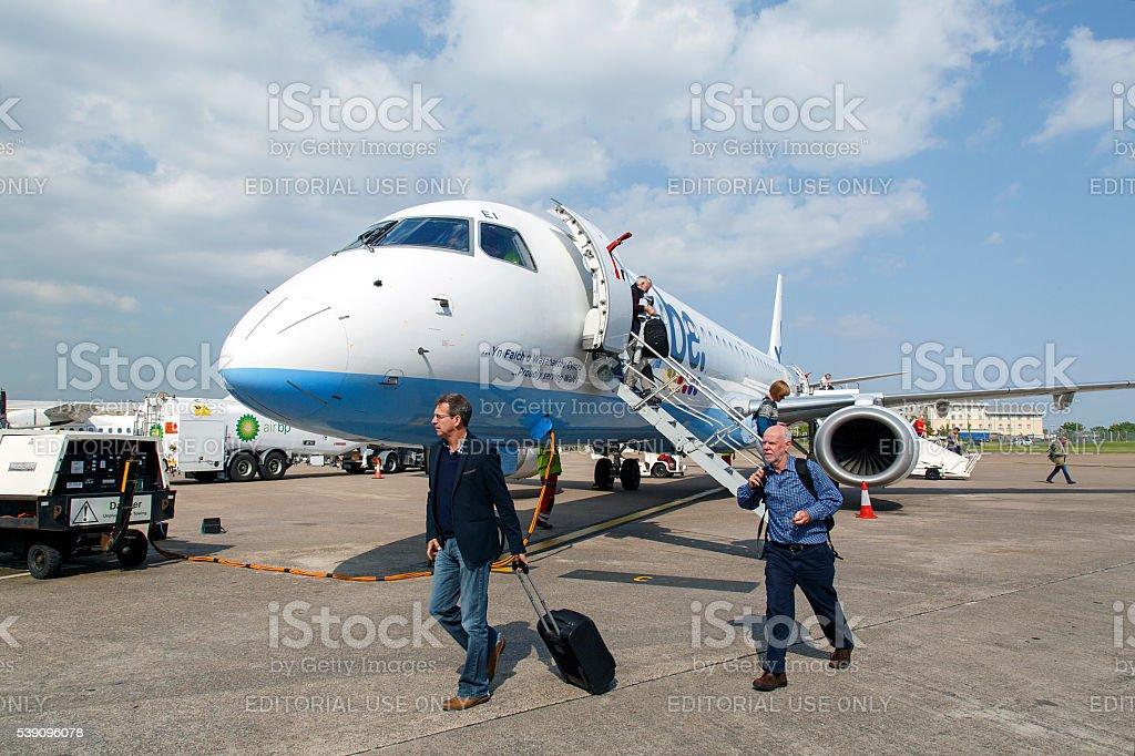 Passengers Disembark from an Aeroplane stock photo