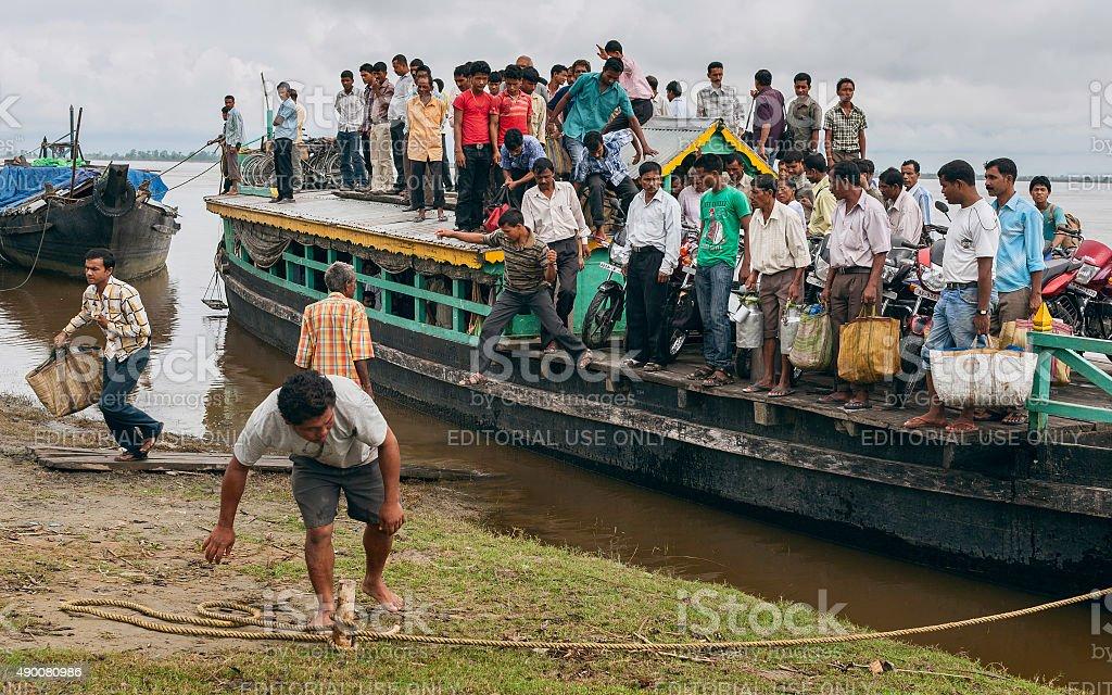 Passengers disembark from ferry at Nimati Ghat, Jorhat, Assam, India. stock photo