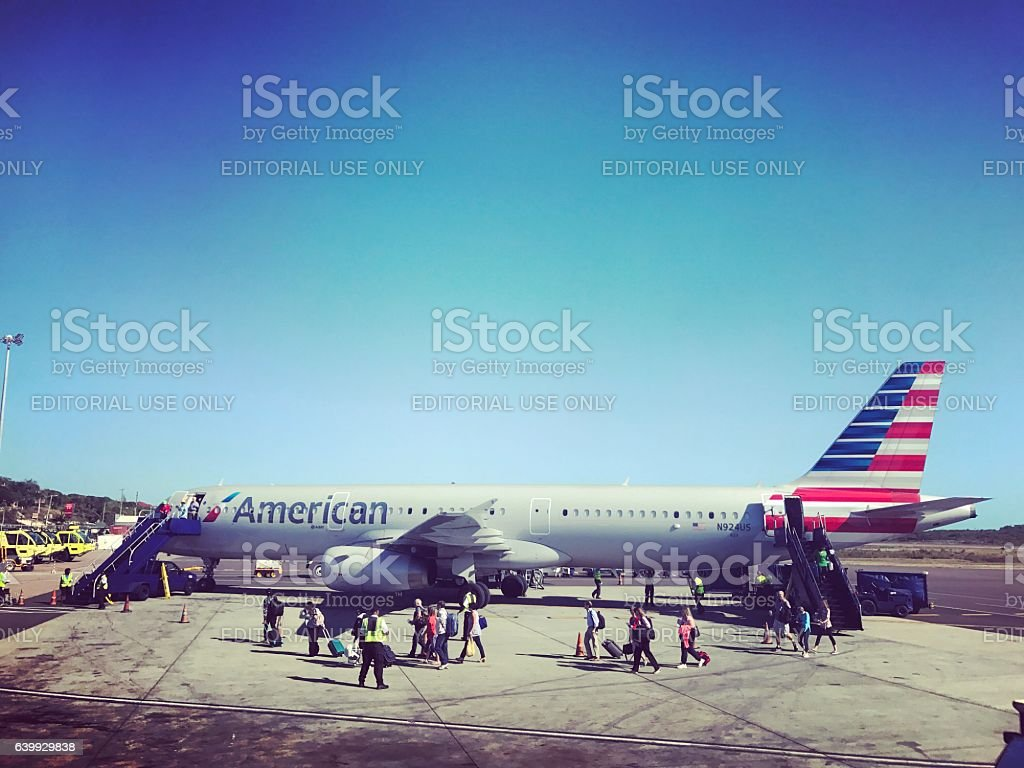 Passengers disembarking from AA flight. Turks and Caicos stock photo