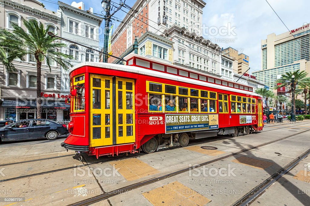 passengers enter the famous red riverfront street car stock photo