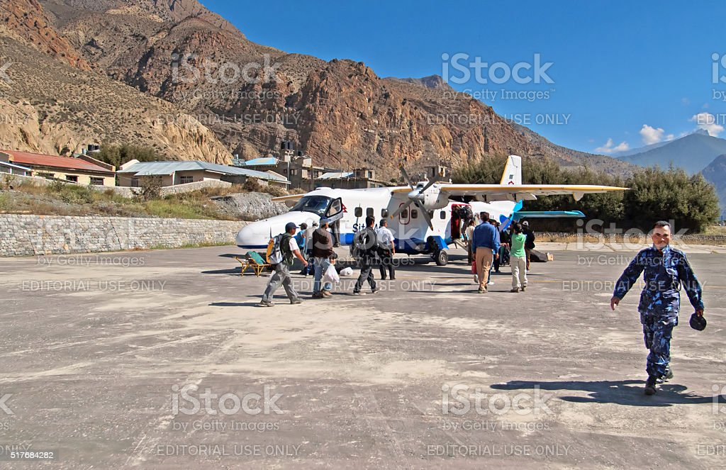 Passengers enter to the plane at the Jomsom airport,, Nepal stock photo