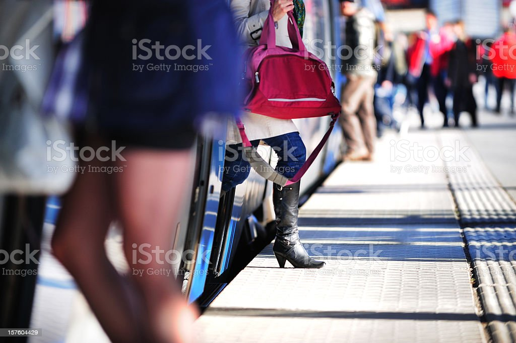 Passengers entering and exiting commuter train stock photo