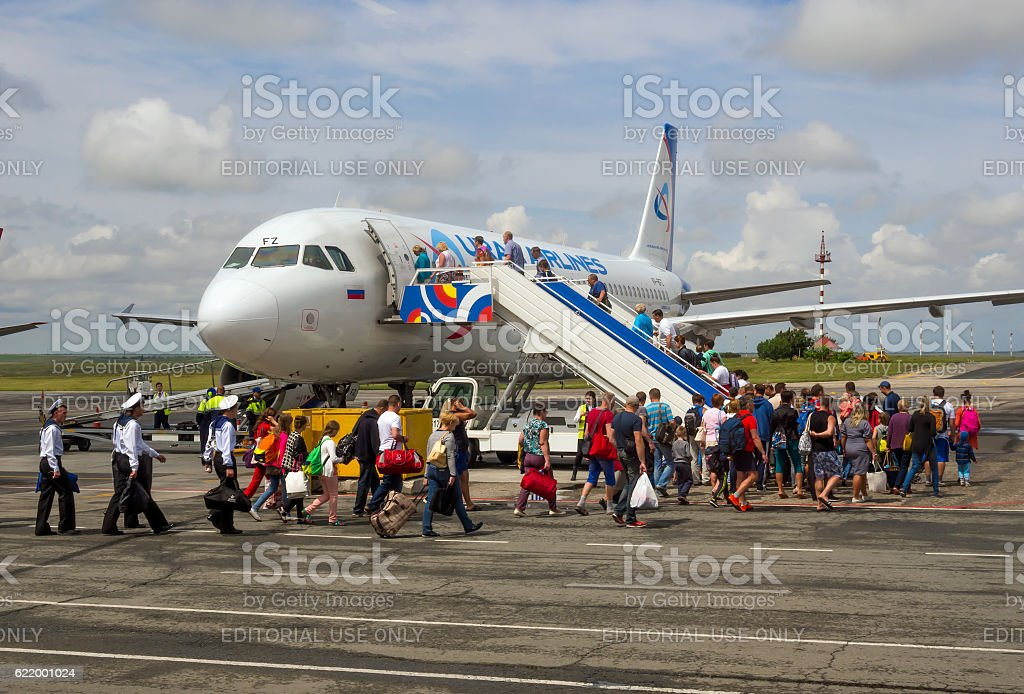 Passengers go on board the aircraft of airline 'Ural Airlines' stock photo