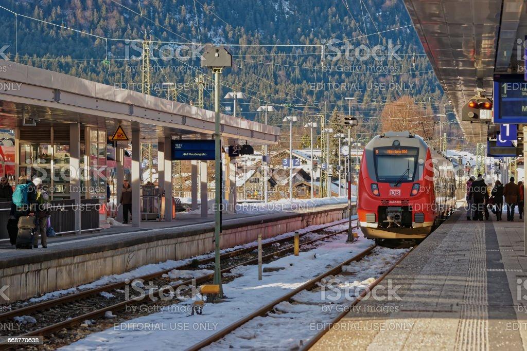 Passengers high speed train at Garmisch Partenkirchen Germany stock photo