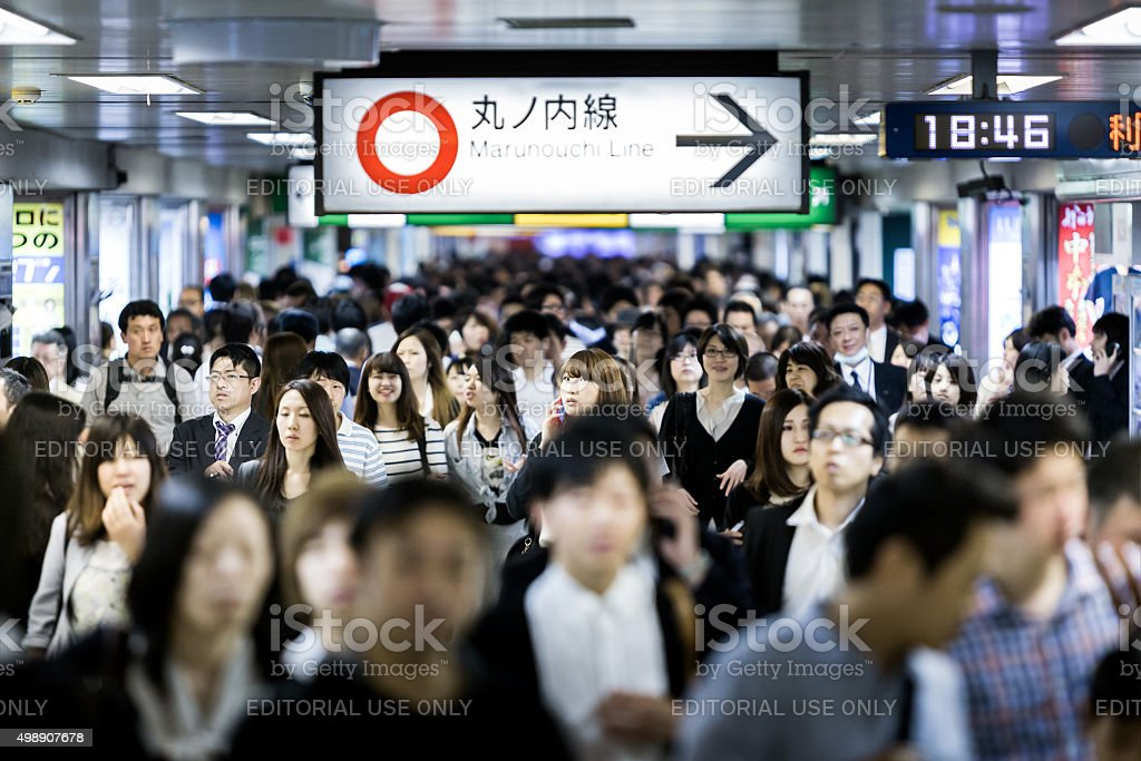 Passengers hurry at Ikebukuro station in Tokyo, Japan stock photo