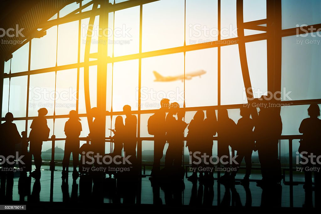 Passengers in an airport stock photo