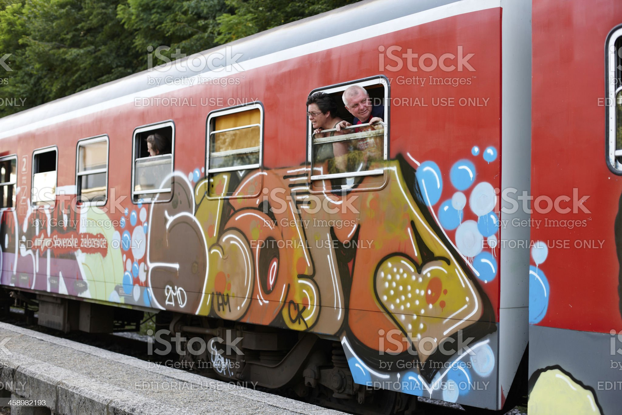 Passengers looking out of window from Slovenian train royalty-free stock photo