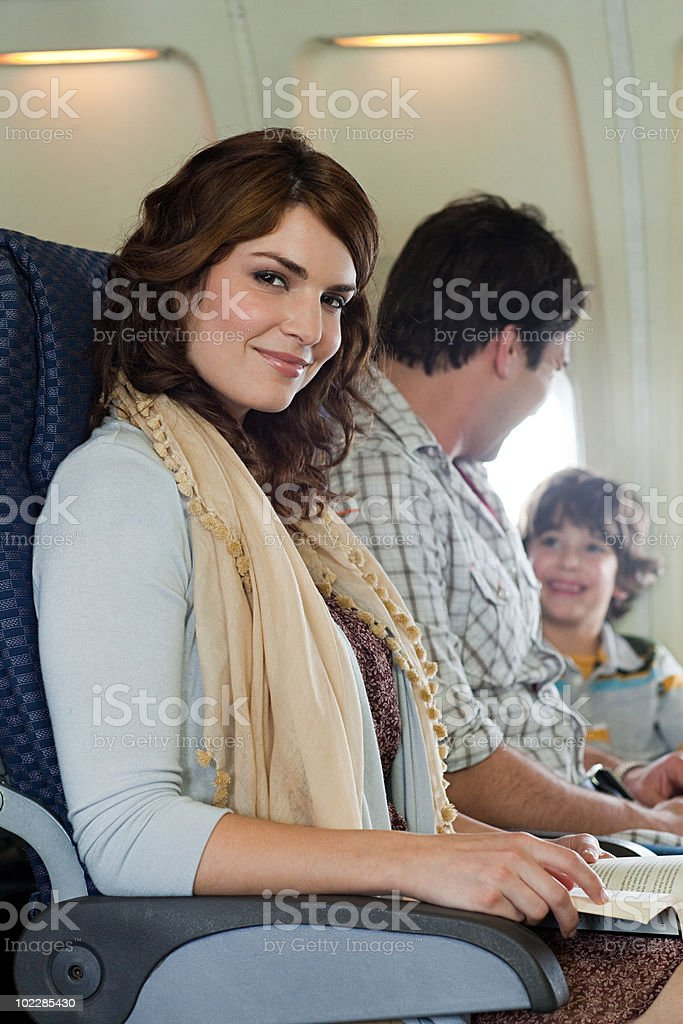 Passengers on an airplane royalty-free stock photo