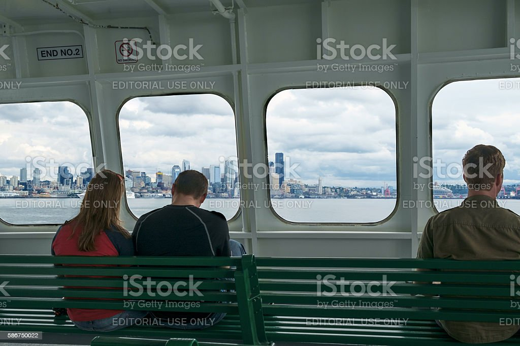 Passengers on ferry approaching Seattle, WA, USA stock photo