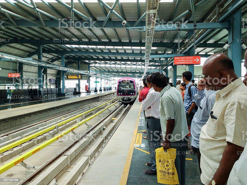 Passengers on Metro station platform, Bangalore, India stock photo