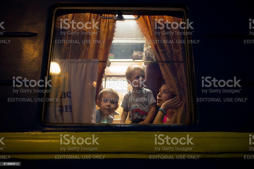 Passengers on night train in Lviv, Ukraine stock photo