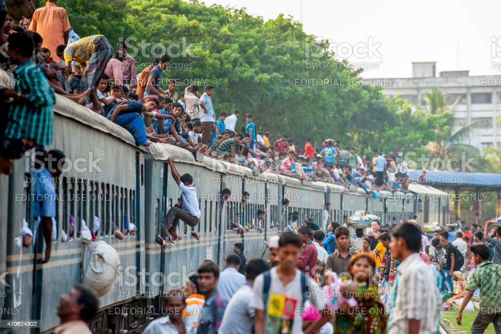 Passengers on the roof of train, Dhaka, Bangladesh stock photo