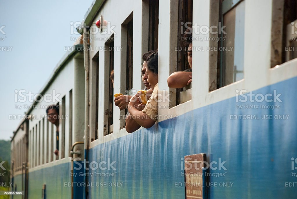 Passengers on train near Kanchanaburi, Thailand stock photo