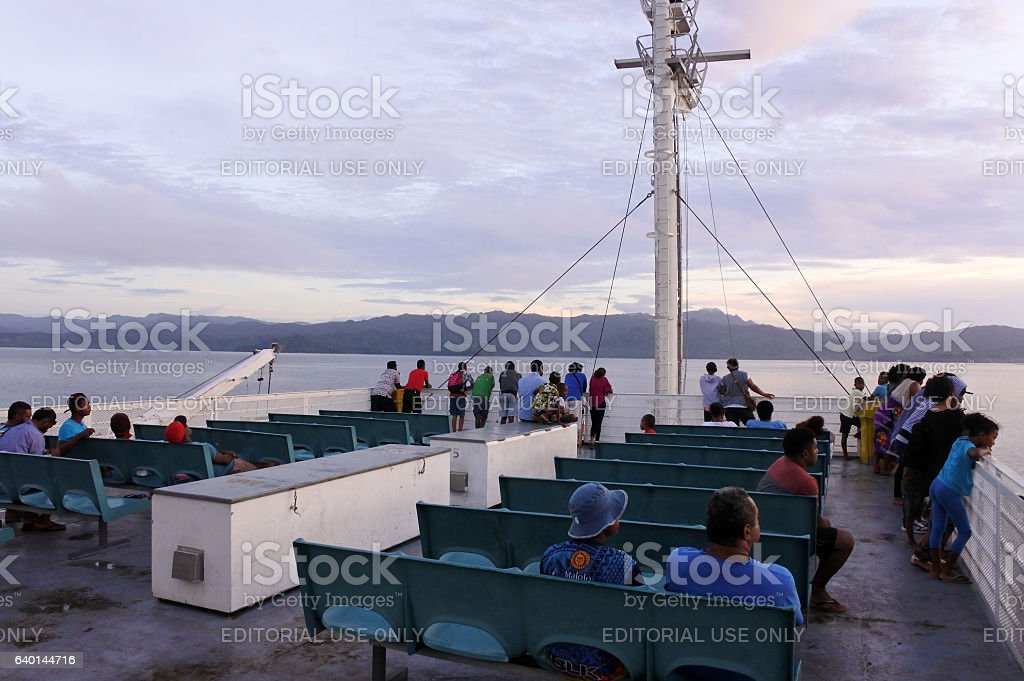 Passengers onboard of inter island ferry in Fiji stock photo