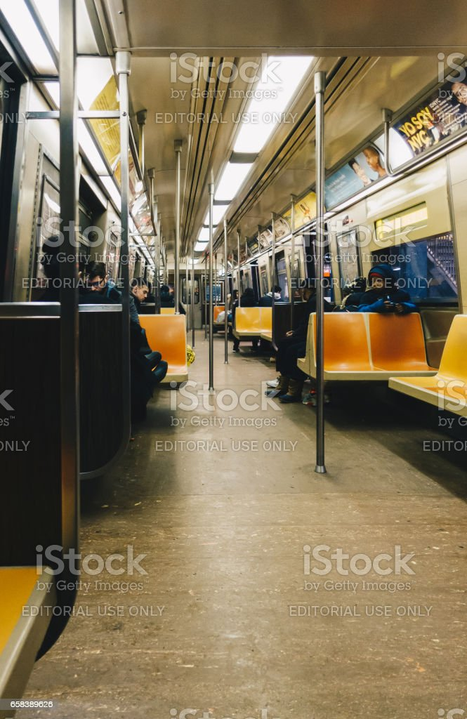 Passengers riding in the NYC Subway. stock photo