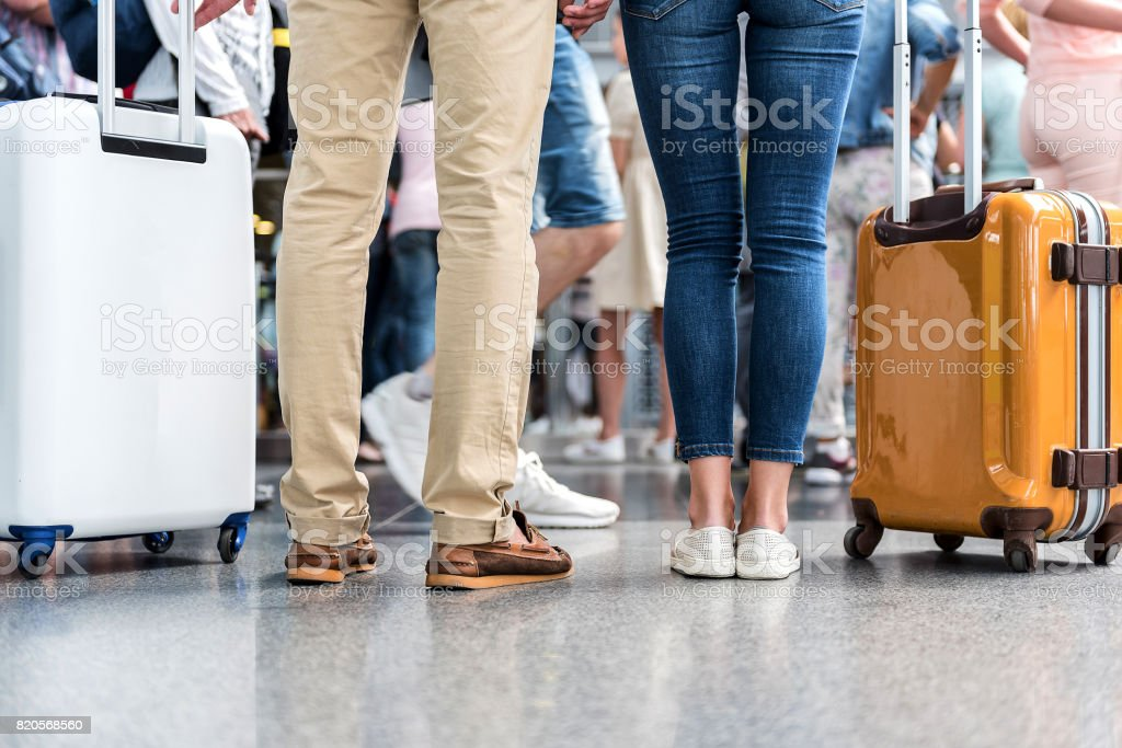 Passengers standing in hall of airport stock photo
