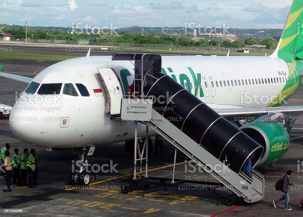 Passengers Stepping Out From Citilink Airline After Arrival.Bali.Airport.Indonesia stock photo