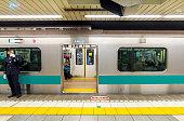 Passengers traveling by Tokyo metro