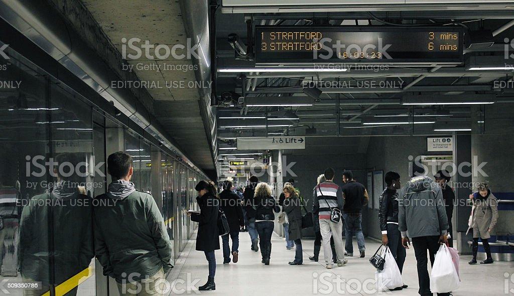 Passengers Wait On London Underground Station Platform stock photo