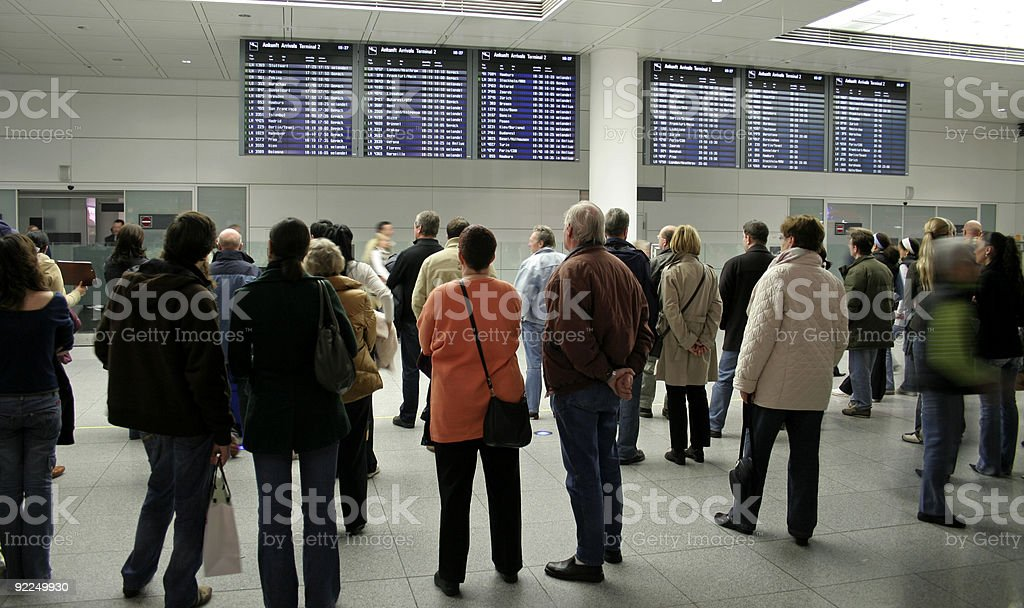 passengers waiting at arrival stock photo