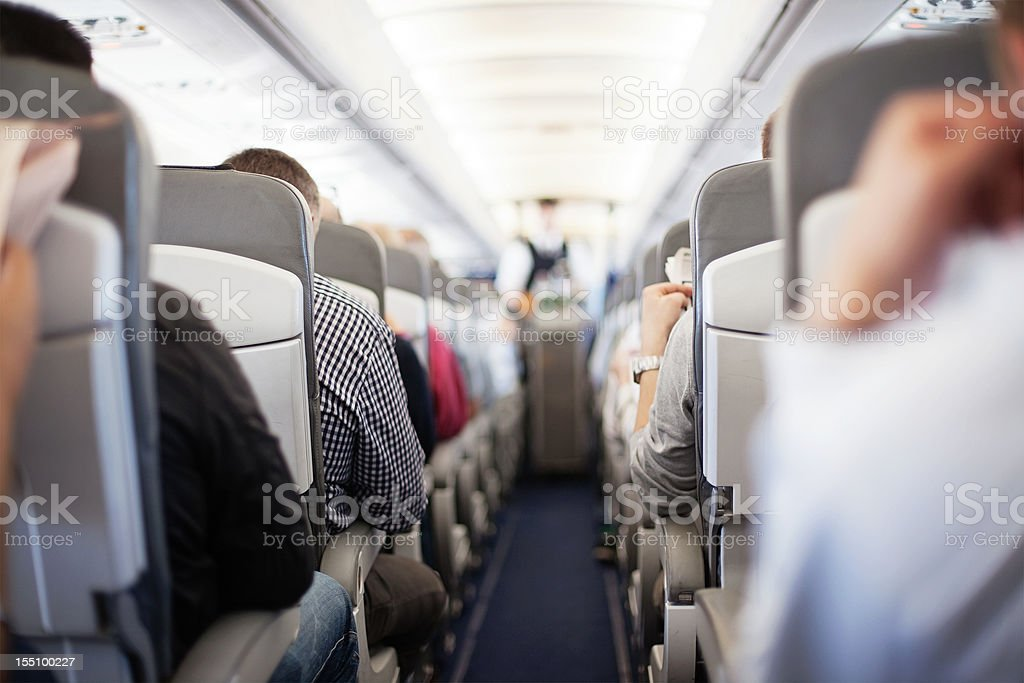 Passengers waiting for in-flight service stock photo