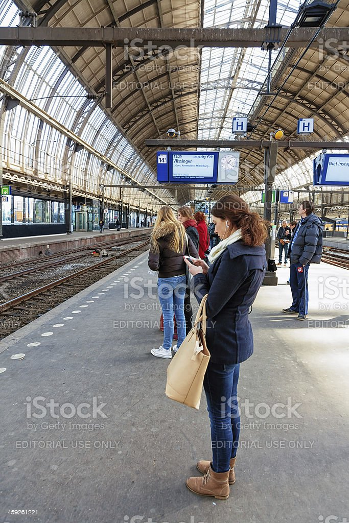 Passengers waiting for the train in Amsterdam Central Station stock photo