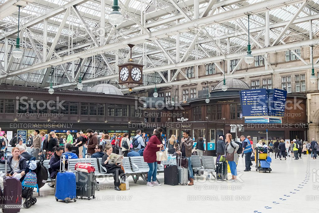 Passengers waiting, sitting, walking around Glasgow Central Train Station stock photo