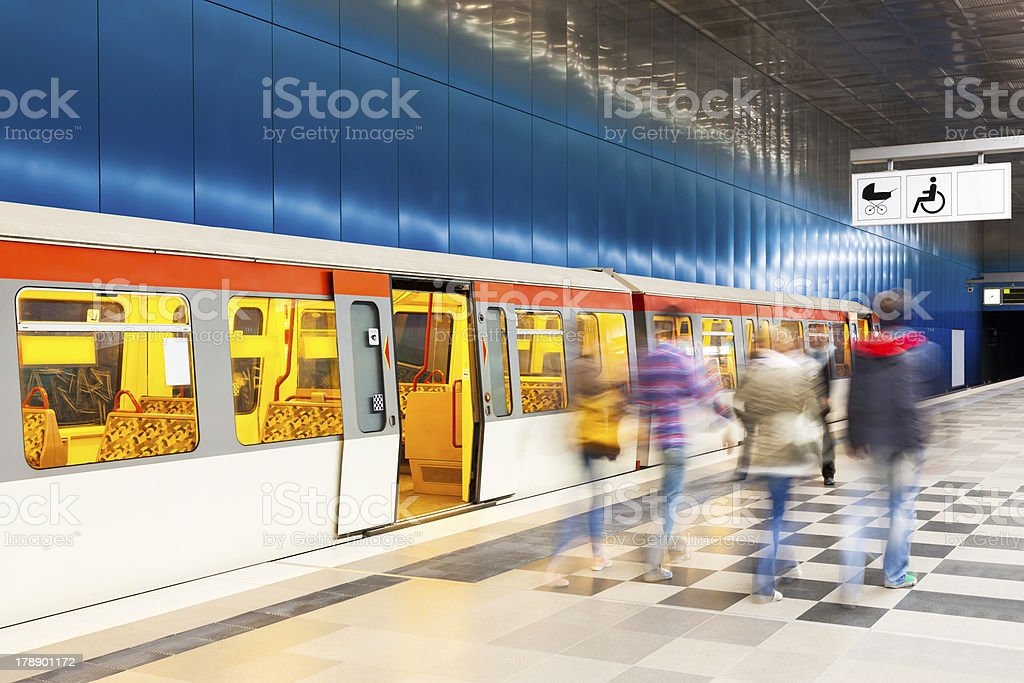 Passengers Walking along Platform in Underground Station royalty-free stock photo
